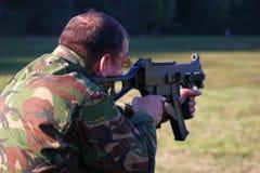 Firing a Machine Gun Royalty Free Stock Image