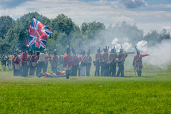 Firing Muskets during War Reenactment Stock Photo