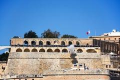 Firing the Noon Gun, Valletta, Malta. Stock Photos