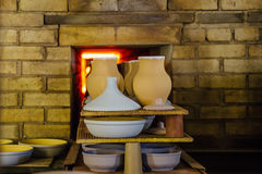 Firing of pottery in the oven Stock Photos