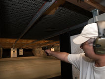 Firing Range. Shooter taking aim on firing range Royalty Free Stock Photos