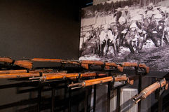Firing squad from Finnish civil war. A display showing rifles used in the Finnish Civil war arranged in a firing squad position in the museum Vapriikki in Royalty Free Stock Images