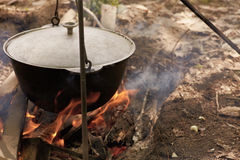 Firing wood under kettle a Stock Image
