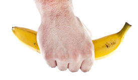 Firm grip on a banana Stock Photo