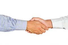 Firm hand shake by two person in formal wear. royalty free stock photos