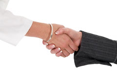 Firm Handshake. Firm female handshake over white Royalty Free Stock Photography