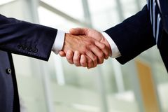 Firm handshake Stock Images