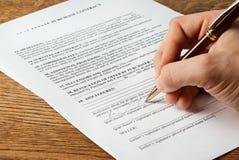 Firma del contrato de las propiedades inmobiliarias Fotografía de archivo