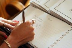 Firma del libro de huésped Foto de archivo