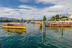 Firma der Schweiz Genf von traditionellen Läufen eine Seenavigation Stockbild