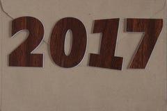 Firme el símbolo del número 2017 en el viejo estilo retro b de madera del vintage Imágenes de archivo libres de regalías
