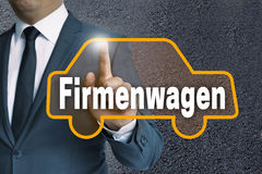 Firmenwagen (in german Company car) auto touchscreen is operated Royalty Free Stock Image