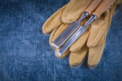 Firmer chisels and leather safety gloves on Royalty Free Stock Photography