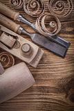 Firmer chisels shaving plane curled shavings wooden mallet on wo Royalty Free Stock Photography