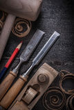 Firmer chisels shaving plane wooden chips mallet Royalty Free Stock Image