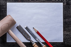 Firmer chisels wooden hammer pencil clean paper construction con Stock Image