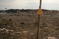 Firmi l'avvertimento circa la zona contaminata tramite radiazione Immagine Stock