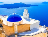 Firostefani, Santorini, Greece: Oold greek church and caldera at Aegean Sea stock photography