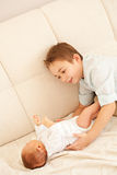 First acquaintance to the newborn sister. Indoor shooting royalty free stock photo