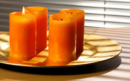 First advent. Candle on a golden plate Royalty Free Stock Photo