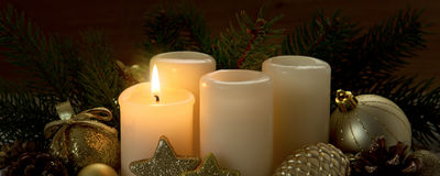 First Advent Candle and Christmas decoration. Royalty Free Stock Photos