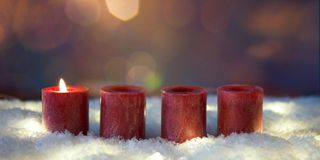 First advent one candle bruning stock images