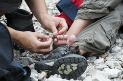 First aid. During a hiking trip in the mountains Stock Images