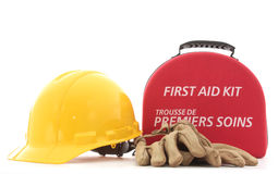 First Aid. A hardhat, gloves, and a first-aid kit to promote safety in the workplace Stock Photography