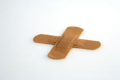 First aid. Adhesive tape in form of a cross Stock Photo