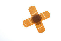 First aid. Adhesive tape in form of a cross Stock Photography