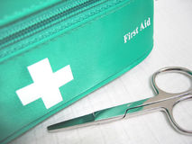 First Aid. Kit with scissors royalty free stock images