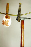 First aid. Injured egg on a washing line Royalty Free Stock Images