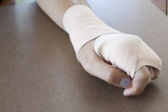 First aid accident wrist with liniment Stock Photo