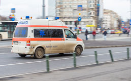 First aid ambulance car driving very fast Stock Photography