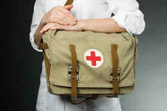 First aid bag in women's hands Stock Image
