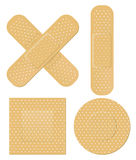First aid bandages. Several shapes of adhesive first aid bandages Stock Photos