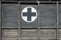 First Aid Black Cross on Wood on Old Retro Ambulance Car Royalty Free Stock Photo