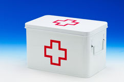 First aid box. On blue background. Copy space Royalty Free Stock Images