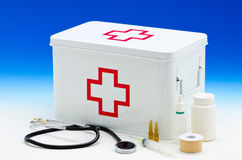 First aid box. And medical supplies in blue background Stock Photography
