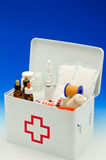 First aid box. Open first aid box filled with medical supplies in blue background Stock Image