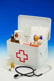 First aid box. Open first aid box filled with medical supplies in blue background Royalty Free Stock Image