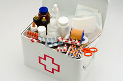 First aid box. Open first aid box filled with medical supplies in white background Royalty Free Stock Photos