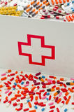 First aid box. Open first aid box filled with pills.  Drugs abuse Stock Images