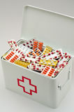 First aid box. Open first aid box filled with pills. White background. Drugs abuse Royalty Free Stock Image