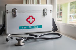 First aid box. And a stethoscope Royalty Free Stock Photo