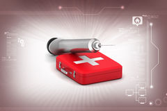 First aid box with syringe. In color background Stock Images