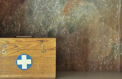 First aid box. Vintage first aid box vith cross Stock Photography