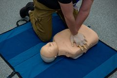 First aid cardiopulmonary resuscitation course. First aid cardiopulmonary resuscitation course using automated external defibrillator device, AED stock photography