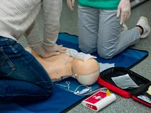 First aid cardiopulmonary resuscitation course. First aid cardiopulmonary resuscitation course using automated external defibrillator device, AED stock image