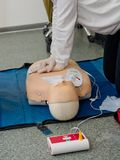First aid cardiopulmonary resuscitation course. First aid cardiopulmonary resuscitation course using automated external defibrillator device, AED royalty free stock image